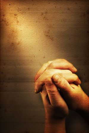Prayers hands and sunbeam on old nostalgic background Stock Photo - 4936007
