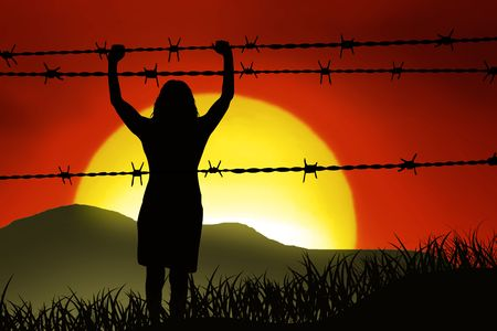 captives: people are captured behind barbed wire Stock Photo