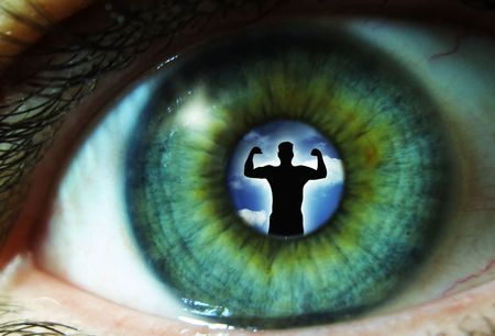 humanism: Pupil of an eye with a silhouette of a man Stock Photo