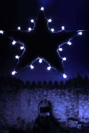bright christmas star in the dark streets photo