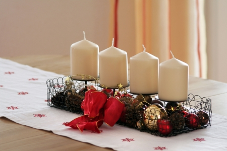 Four candles in the Christmas time advent photo