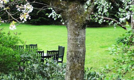 table and chairs outdoors in a nice garden photo