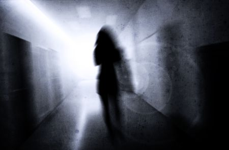 psychic: woman with psychic pressure in a corridor