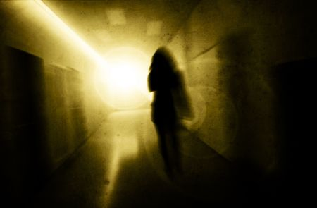 fearing: woman with psychic pressure in a corridor