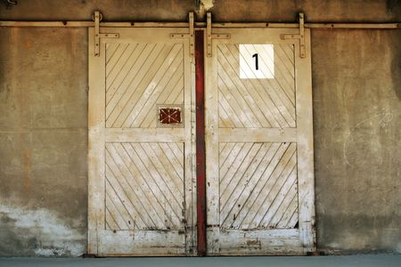 entrance with door handle of an old ware house photo
