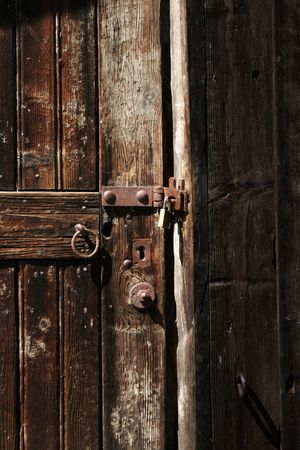 entrance with door handle of an old ware house Stock Photo - 4940545