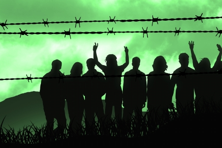 war refugee: people are captured behind barbed wire Stock Photo