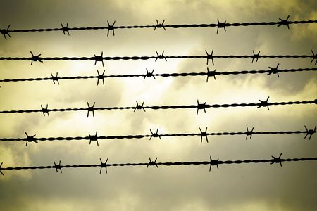 people are captured behind barbed wire Stock Photo - 4940358