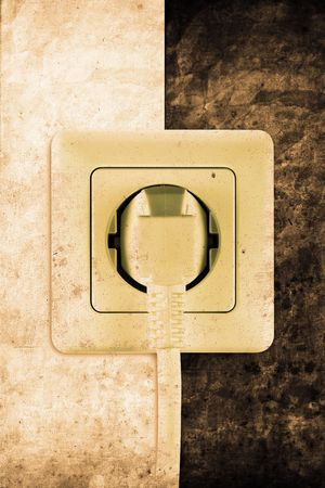 plugged: old socket with plugged cable in retro design look