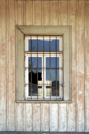 old broken window of a historical jail photo