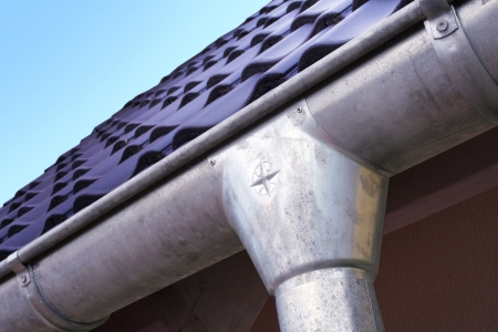 roofing system: New house with roofing tiles and gutter Stock Photo