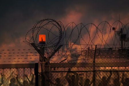 the barbed wire with clouds and sunblades Stock Photo - 5100614