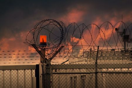 political prisoner: the barbed wire with clouds and light Stock Photo