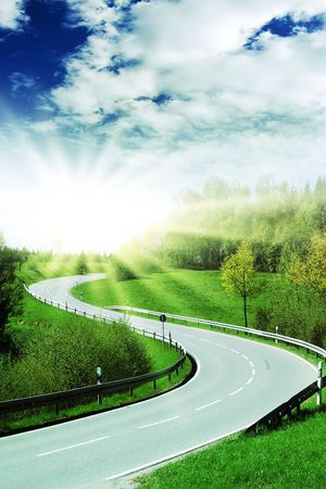 curve of a highway with bright sun photo