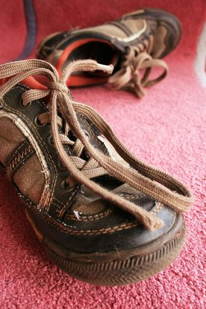 Beautiful old sport shoes of a little boy photo