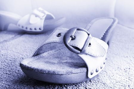 two Beautiful white sandal summer leather shoes  photo