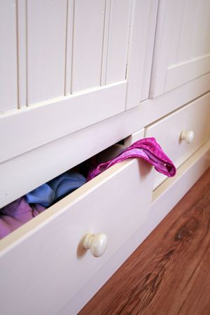 white furniture with open drawer and underpants Stock Photo