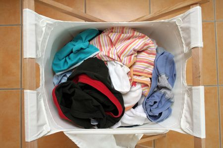 dirty clothes in a wooden loundry basket Stock Photo - 5277837
