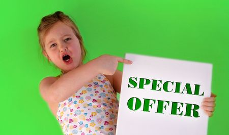A girl is holding a special offer frame in her hands photo