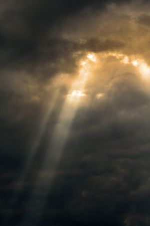 dark clouds with sunny beam through the sunburst photo