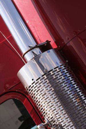 The beautiful red US Truck with chrome exhaust photo