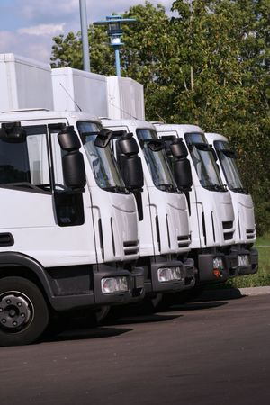 fleet: four trucks of a transporting company in a row