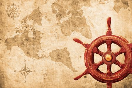 ship steering wheel: steering wheel with a navigator and lighthouse Stock Photo