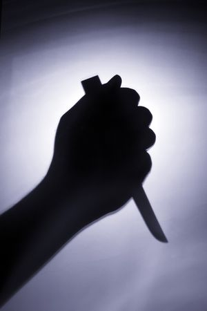 stab: the hand of a murder is holding the knife