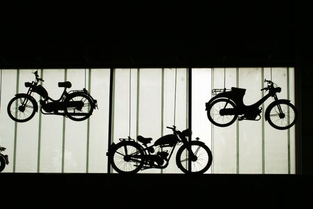 oldies: silhouettes of old motorbikes on the wall