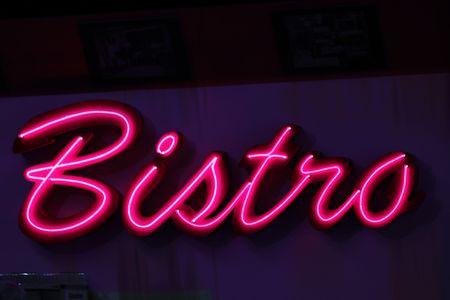 red luminous advertising of a bistro pub photo