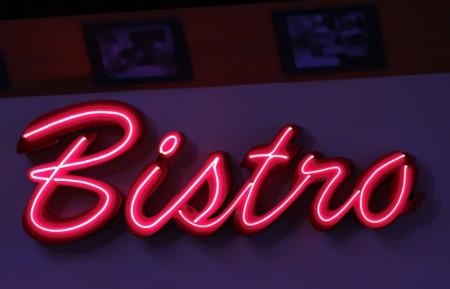 bistro: red luminous advertising of a bistro pub