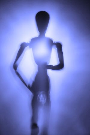 immovable: blurry silhouette of a figure in motion  Stock Photo