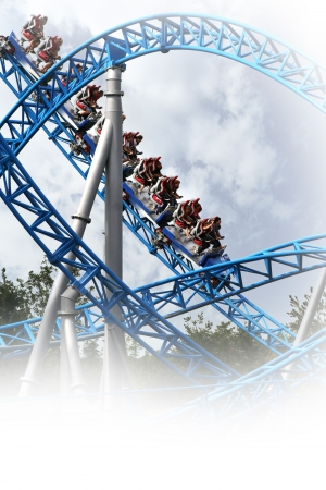 roller coaster: people in the looping of a fast roller coaster Stock Photo