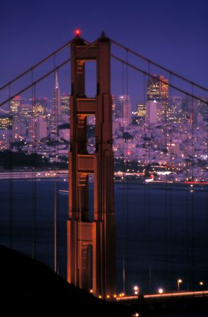 san francisco and golden gate bridge at night photo