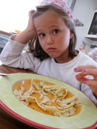 girl do not want to eat her noodles photo