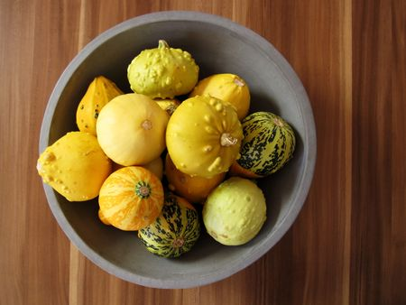 cymbling: any marrows as still life on a wooden table