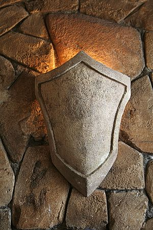 shield light on the wall of an old castle photo