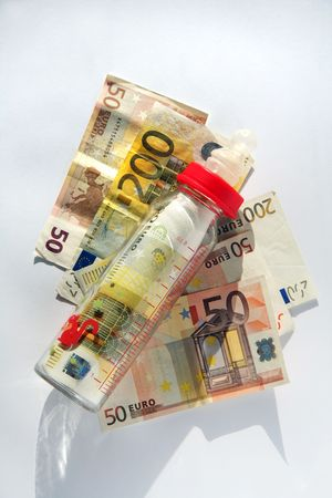 financial reward: Babys bottle with many bills of euro Stock Photo