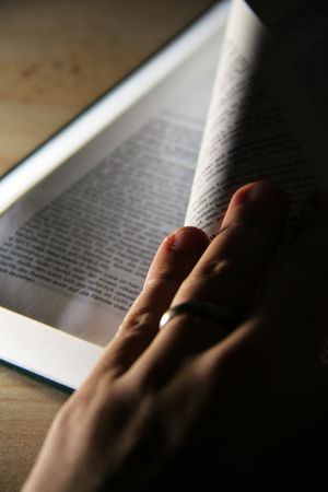 opened pages of a book on wooden table Stock Photo - 6088456
