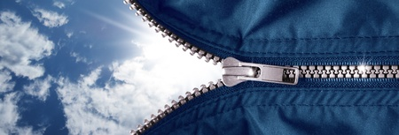 opened zipper with blue sky Stock Photo - 9167328