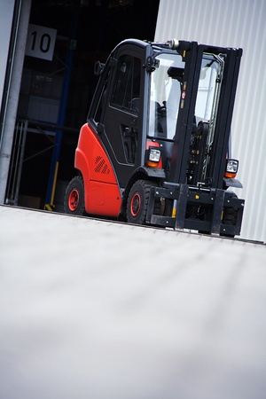the red forklift in a logistic warehouse with photo