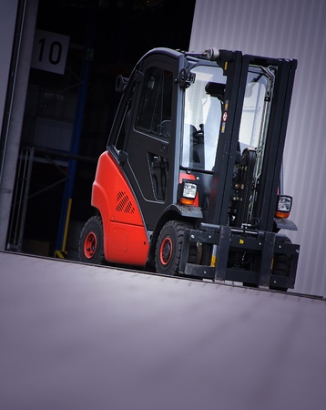 the red forklift in a logistic warehouse with