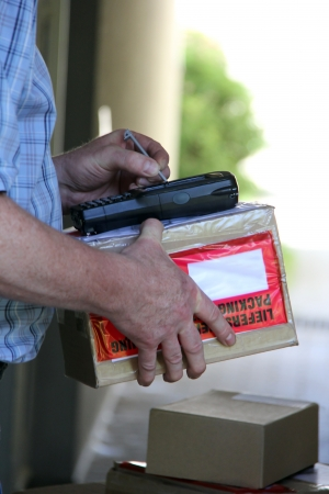 mail man: Parcel delivery with hand signature on handheld computer