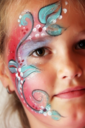 children painting: little girl with body painted flower face