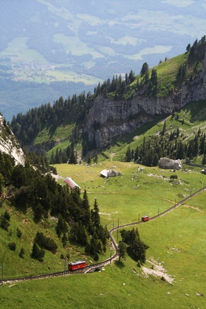 narrow gauge railways: red swiss rack railroad in the mountains Stock Photo