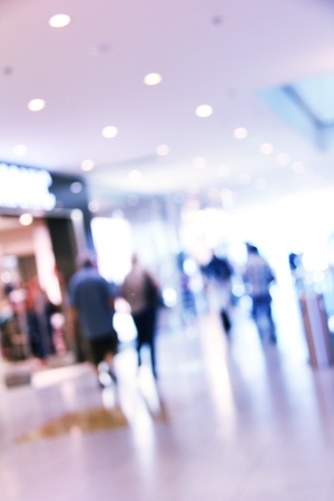 blurred unrecognizable people in motion in a shopping mall Stock Photo