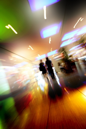 busy life: blurred unrecognizable people in motion in a shopping mall Stock Photo