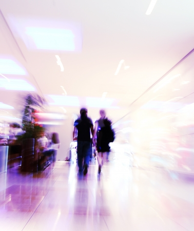 blurred unrecognizable people in motion in a shopping mall Stock Photo - 10569775