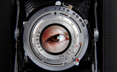 photographic: Old Camera with eye effect  in the lens Stock Photo