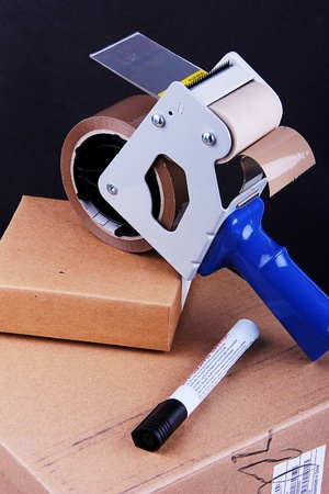 tape dispenser and pen with parcel boxes photo